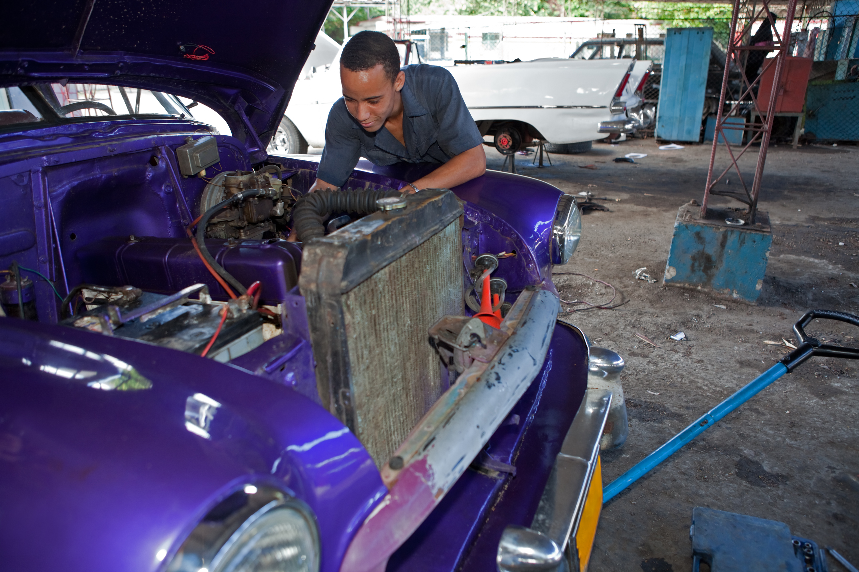 An auto mechanic, working on an automobile